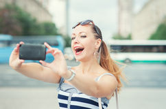 Beautiful woman taken picture of herself in the city Royalty Free Stock Images