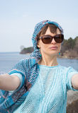 Beautiful woman taken picture of herself, selfie. Royalty Free Stock Photo