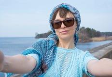 Beautiful woman taken picture of herself, selfie. Stock Photo