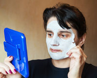 Beautiful woman takes beauty mask Stock Image