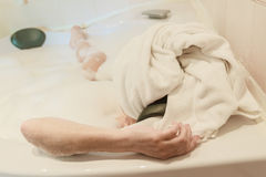 Beautiful woman takes bubble bath Stock Images