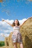 Beautiful Woman takes Fun near Haystack Stock Images