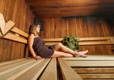 Beautiful woman takes relaxation in the sauna. Stock Photo