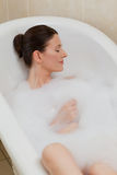 Beautiful woman taking a bath Royalty Free Stock Images