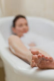 Beautiful woman taking a bath Stock Image