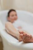 Beautiful woman taking a bath Stock Image