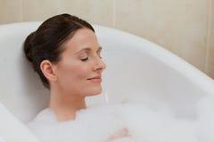 Beautiful woman taking a bath Royalty Free Stock Photos