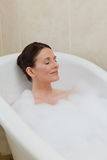Beautiful woman taking a bath Royalty Free Stock Photos
