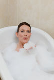 Beautiful woman taking a bath Royalty Free Stock Photography