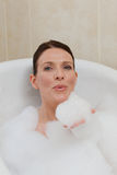 Beautiful woman taking a bath Royalty Free Stock Photo