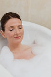 Beautiful woman taking a bath Stock Photo