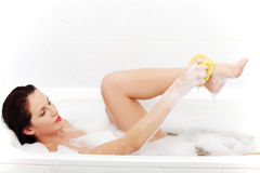 Beautiful woman taking the bath. Royalty Free Stock Photography
