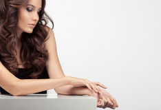 Beautiful woman taking care of her hands. Space for text. Royalty Free Stock Photos