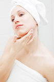 Beautiful Woman Taking Care Of Her Skin Stock Images