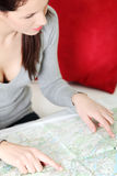 Beautiful woman taking a look at a map. Stock Photo