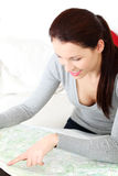 Beautiful woman taking a look at a map. Stock Images