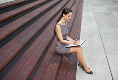 Beautiful Woman Taking Notes Stock Photo