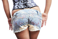 Beautiful woman taking off her daisy dukes Stock Images