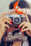 Beautiful woman taking photo with old fashioned film camera Royalty Free Stock Image
