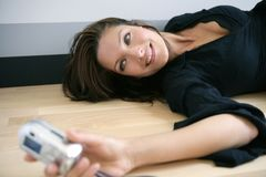Beautiful woman taking photos herself stock photography