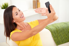 Beautiful woman taking photos with a mobile phone Stock Image
