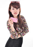 A beautiful woman taking pictures with cell phones Stock Images