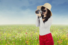 Beautiful woman taking pictures at outdoors Stock Photos