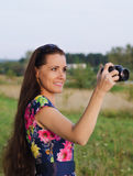 Beautiful woman taking pictures of sunset Stock Photos