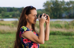 Beautiful woman taking pictures of sunset Stock Image