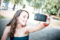Beautiful woman taking self-portrait Royalty Free Stock Photos