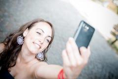 Beautiful woman taking self-portrait Royalty Free Stock Photo