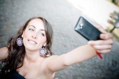 Beautiful woman taking self-portrait Stock Image