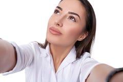 Beautiful woman taking selfie Stock Images