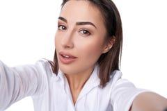 Beautiful woman taking selfie Royalty Free Stock Image