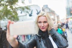 Beautiful woman taking a selfie  in London Stock Photos
