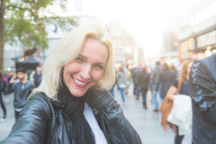 Beautiful woman taking a selfie  in London Royalty Free Stock Photography