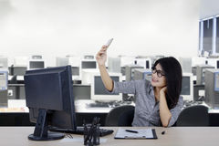 Beautiful woman taking selfie picture in office Stock Photography