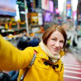 Beautiful woman taking a selfie on Times Square Royalty Free Stock Photos