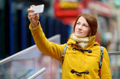 Beautiful woman taking a selfie on Times Square Stock Photos