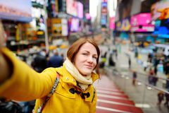 Beautiful woman taking a selfie on Times Square Stock Image