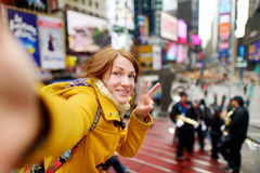 Beautiful woman taking a selfie on Times Square Royalty Free Stock Images