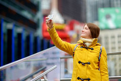 Beautiful woman taking a selfie on Times Square Royalty Free Stock Photography