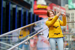 Beautiful woman taking a selfie on Times Square Stock Images