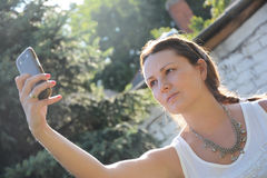 Beautiful woman taking selfie Royalty Free Stock Images