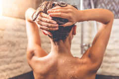 Beautiful woman taking shower stock images