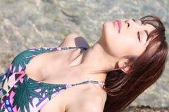 Beautiful woman taking a sunbath Royalty Free Stock Images