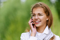 Beautiful woman talking on cell Stock Image