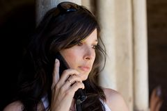 Beautiful woman talking on cell phone Royalty Free Stock Photography