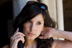 Beautiful woman talking on cell phone Royalty Free Stock Images
