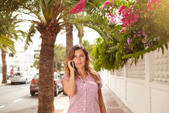 Beautiful woman talking on cell phone outdoors Royalty Free Stock Image
